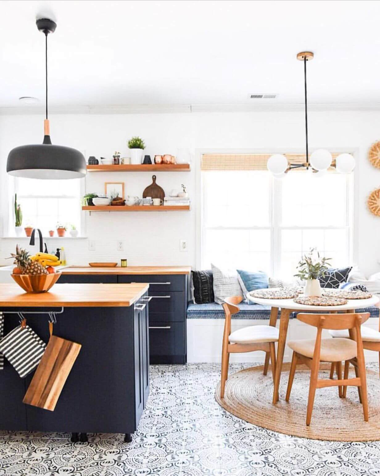 mid century modern farmhouse kitchen with cement tiles and open shelving